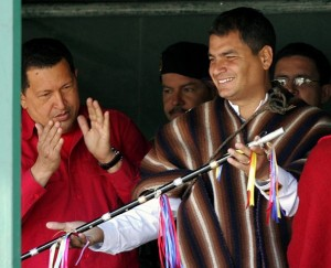 President Rafael Correa (right) accepts a ceremonial staff, as Pres Hugo Chavez looks on, one day before Correa's 2007 inauguration.
